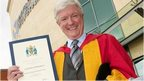 Tony Hall collecting his honorary doctor of arts award