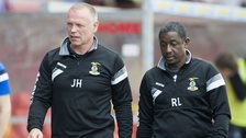Inverness manager John Hughes and assistant Russell Latapy