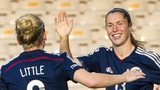 Kim Little rushes to congratulate Scotland team-mate Jane Ross