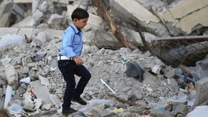 A young Palestinian schoolboy heads for his school on the first day of the new school year (14 September 2014)