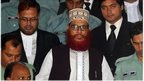 Jamaat-e-Islami leader Delwar Hossain Sayeedi (C) emerges from the Bangladesh International Crimes Tribunal in Dhaka on August 18, 2011.