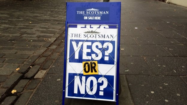 A billboard for The Scotsman newspaper
