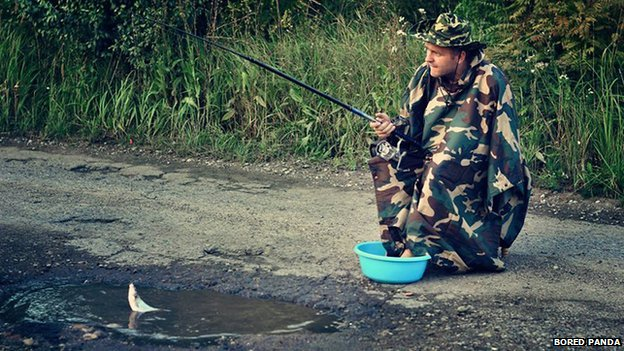 Man fishing in pothole
