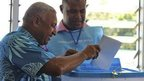 Fiji's military ruler Voreqe Bainimarama, left, casts his vote in a national election in Suva, Fiji, 17 September 2014