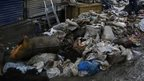 Garbage is dumped by the roadside as flood waters recede in Srinagar, Indian-controlled Kashmir, Tuesday, Sept. 16, 2014