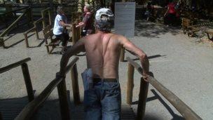 Older man doing press ups on parallel