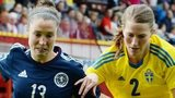 Scotland ace Jane Ross tries to make her way past Sweden's Emma Berglund (right)