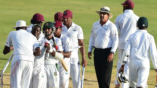 Bangladesh and West Indies players shake hands after the second Test