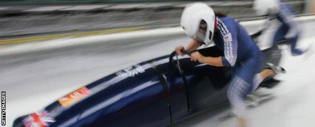 Nicola Minichiello and Jacqui Davies compete at the 2006 Winter Olympics