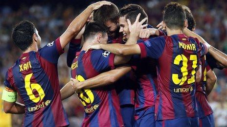 Barcelona players celebrate scoring against Apoel Nicosia in the Champions League