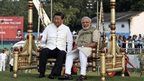 Chinese President Xi Jinping, left and Indian Prime Minister Narendra Modi, sit on a traditional swing at the Sabarmati River front in Ahmadabad, India, Wednesday, Sept. 17, 2014.