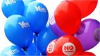 Yes and No balloons are held by people at a rally in Glasgow, Scotland, 17 September 2014