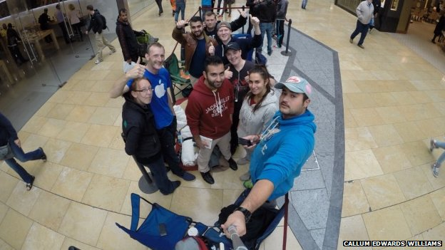 Callum Edwards-Williams takes a selfie of himself and the other people in the queue