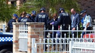 Forensic experts collect evidence from a house in the Guildford area of Sydney on 18 September 2014
