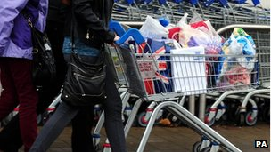Shoppers leave a Tesco store