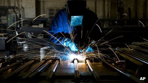 A welder fabricates anchor bolts for roads and bridges