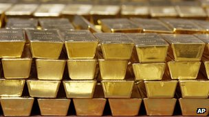 Gold bars stacked on top of one another