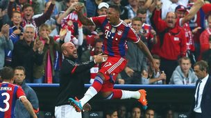 Jerome Boateng of Bayern Muenchen jumps for joy