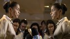 The image of Brazilian presidential candidate Marina Silva is reflected in a mirror as she speaks at a news conference in Rio de Janeiro (17 September 2014)