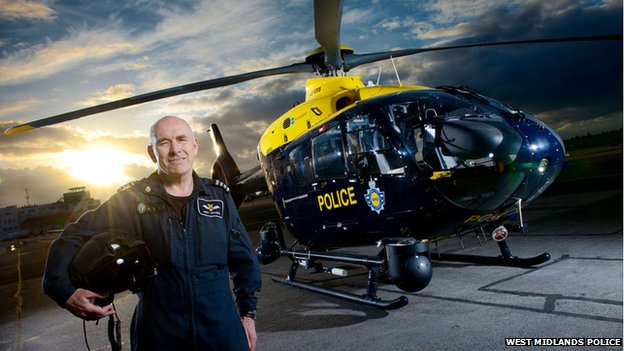 Andy Shanks next to the helicopter