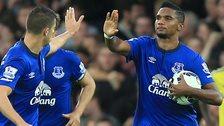Samuel Eto'o celebrates with Everton team-mate Kevin Mirallas
