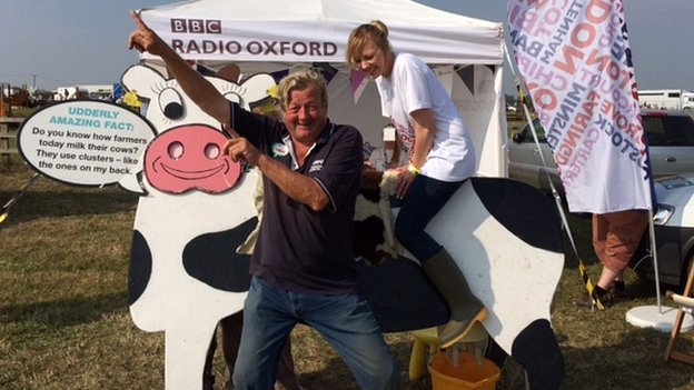 Sara Dumbell on a cow, with Johnny Ball from the NFU