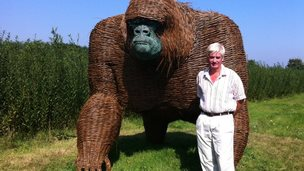 Sculptor Robert Yates with the wicker gorilla