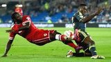 Cardiff striker Kenwyne Jones is challanged by Middlesbrough's Kenneth Omeruo