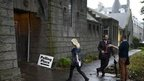 A voter arrives to cast her ballot at the Queen's Cross parish church in Aberdeen