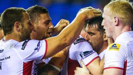 Wigan Warriors players celebrate Matty Smith's try
