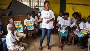 A charity worker educates children on how to prevent and identify the Ebola virus in their communities at Freetown, Sierra Leone (18 September 2014)