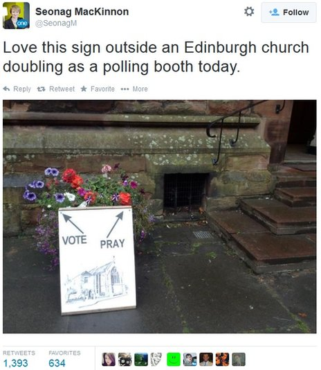 A sign reading 'vote' and 'pray' outside polling booth in a church