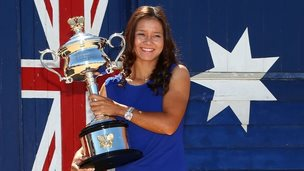 Li Na poses with the Daphne Akhurst Memorial Cup at Brighton Beach, after winning the 2014 Australian Open, on 26 January 2014 in Melbourne, Australia