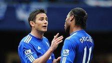 Frank Lampard embraces Didier Drogba