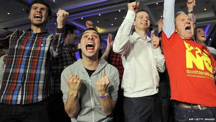 "Pro-union supporters celebrate as Scottish independence referendum results come in at a ""Better Together"" event in Glasgow, Scotland"