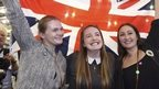 """Supporters from the """"No"""" Campaign celebrate as they hold up a Union flag, in Edinburgh, Scotland September 19, 2014"""