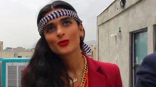 A still image from the 'vulgar' Happy video