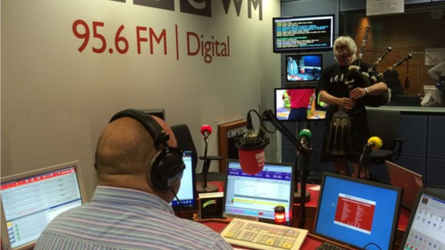 Andy King plays the bagpipes in the studio