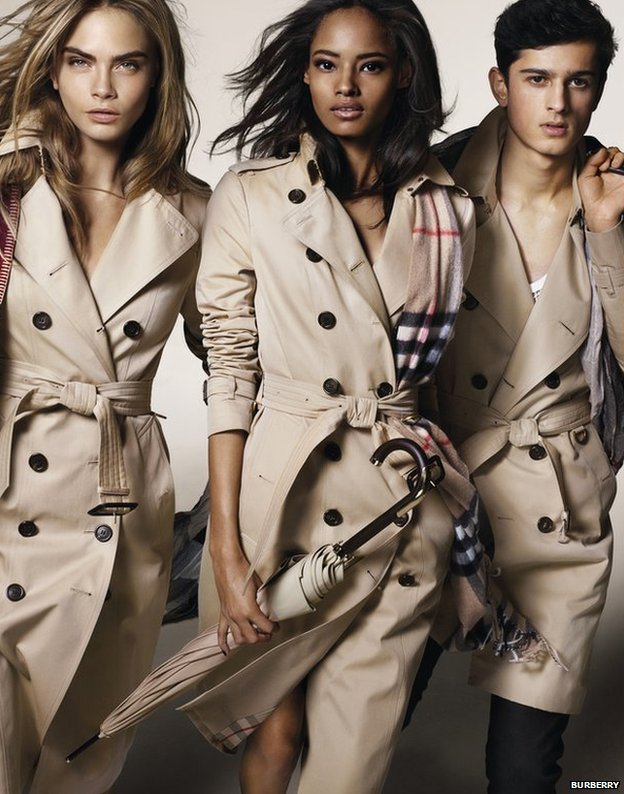 Models Cara Delevingne, left, Malaika Firth, centre, and Tarun Nijjer feature in Burberry's latest ad campaign