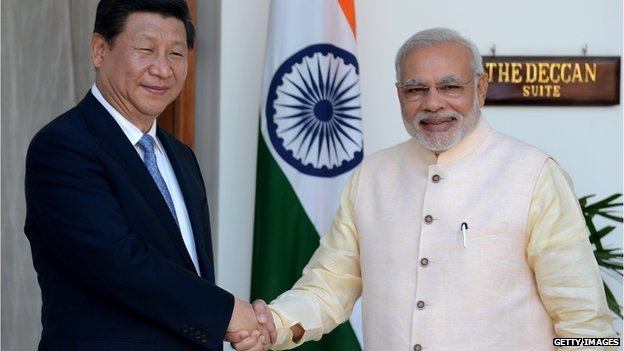 Chinese President Xi Jinping (left) and Indian Prime Minister Narendra Modi
