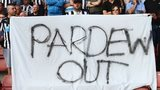 Newcastle fans at St Mary's hold up a banner calling for Pardew to be sacked