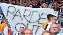 Newcastle supporters hold a 'Pardew Out' banner at St Mary's Stadium