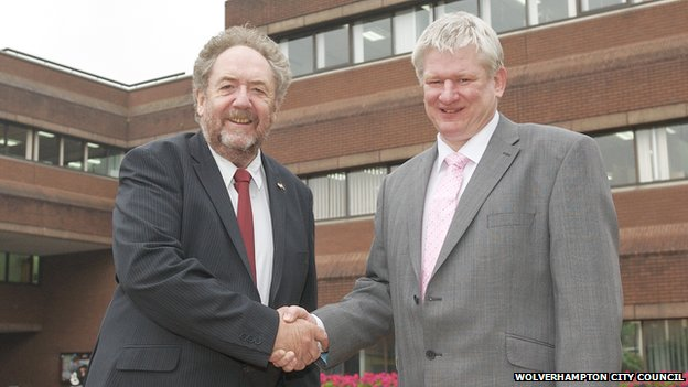 Councillor Roger Lawrence (left), council leader, congratulates Keith Ireland (right)