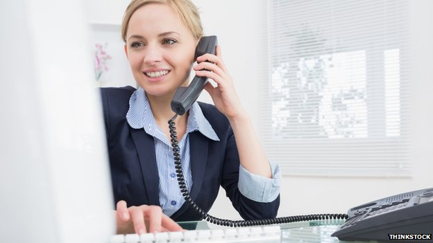 Woman on the phone in office