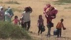 Kurdish refugees heading towards Turkish border
