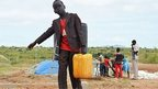 A South Sudanese boy carrying a jerry can of water, Juba, South Sudan - Wednesday 17 September 2014