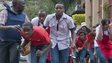 Civilians who had been hiding inside during gun battles manage to flee  from the Westgate Mall in Nairobi, Kenya Saturday, 21 September 2013