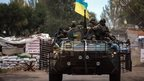 Ukrainian soldiers drive on a Armored Personnel Carrier (APC) in Kramatorsk town, near Slaviansk, Ukraine, 11 September 2014