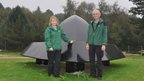 Olivia English and Nigel Turner with the Rendlesham Forest UFO sculpture
