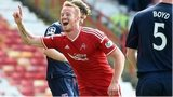 Adam Rooney celebrates after scoring for Aberdeen against Ross County